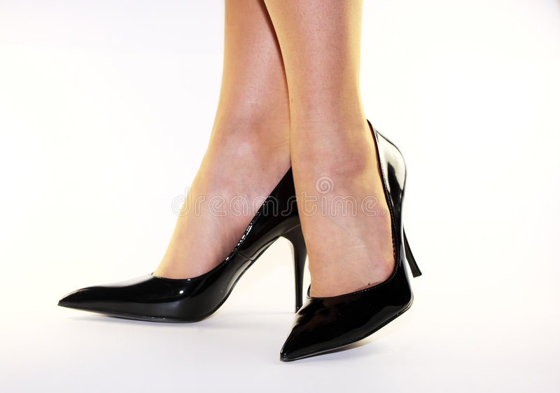 Black high heels. Woman legs in black high heels on white background royalty free stock photos