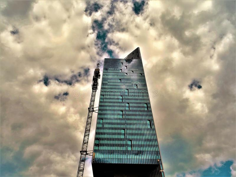 Black High-rise Building With White Clouds stock photography