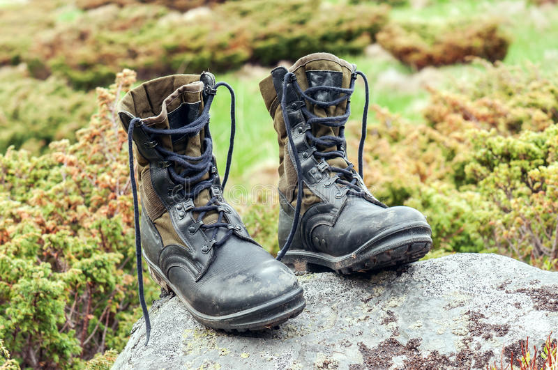 Black hiking boots. Black hiking (military) boots on the stone royalty free stock image