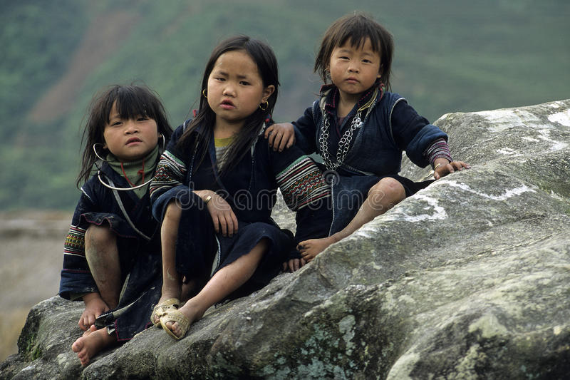 Black Hmong Children. Siiting along the road near Bac-Ha, North-Vietnam royalty free stock photography