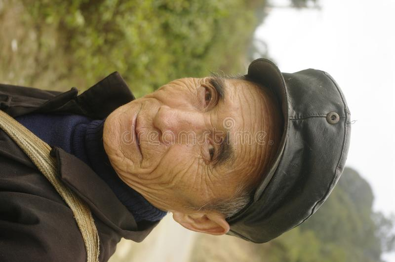 Black Hmong ethnic man. Man of the Hmong in traditional dress. He wears the hat because we Chinese are near the border stock images