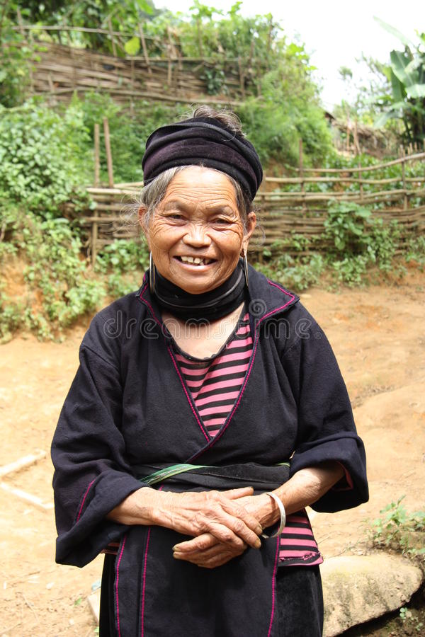 Black Hmong old woman smiling, Sapa, Vietnam. Black Hmong old woman in traditional ethnic dress smiling, Sapa, Vietnam stock images