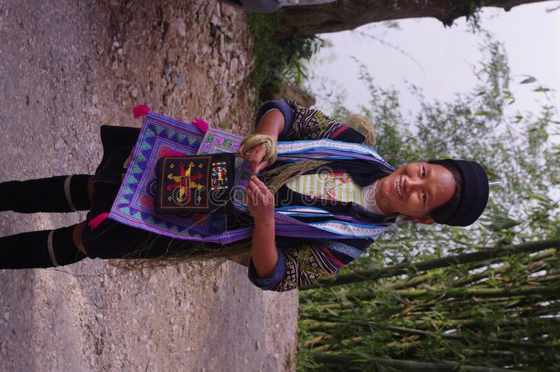 Black Hmong Woman. Black Hmong young women in the region of SAPA (North Vietnam). Hmong women still wear a dress. The Black Hmong women are dressed all in black stock photos