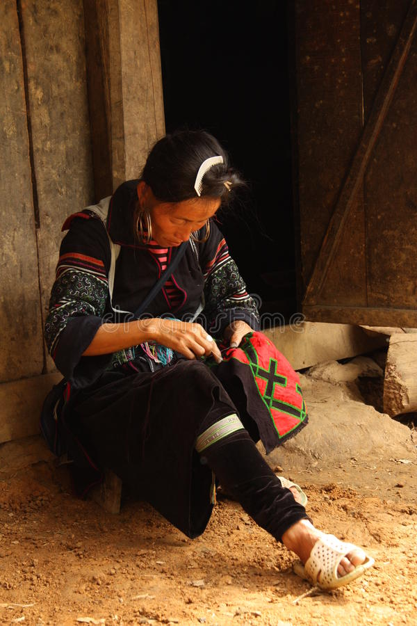 Black Hmong woman sewing costume, Sapa, Vietnam royalty free stock photo