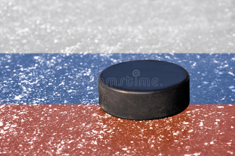 Black hockey puck royalty free stock photos