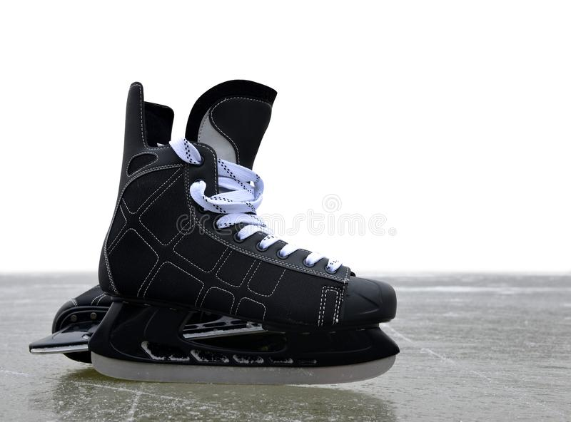 Black hockey skates on a ice rink. royalty free stock photos
