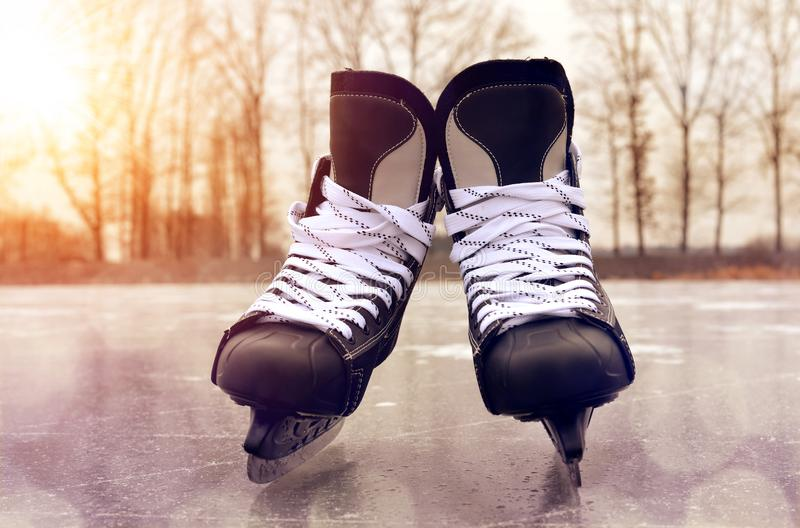 Black hockey skates on a ice rink. royalty free stock image