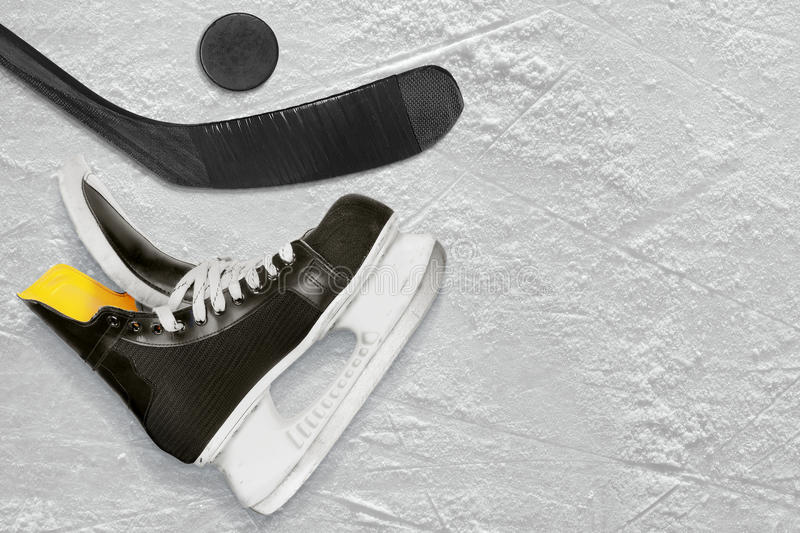 Black hockey stick, skates and the puck stock photo