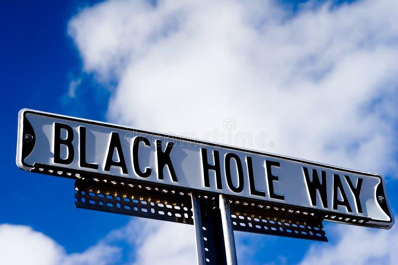 Black hole way sign stock photos