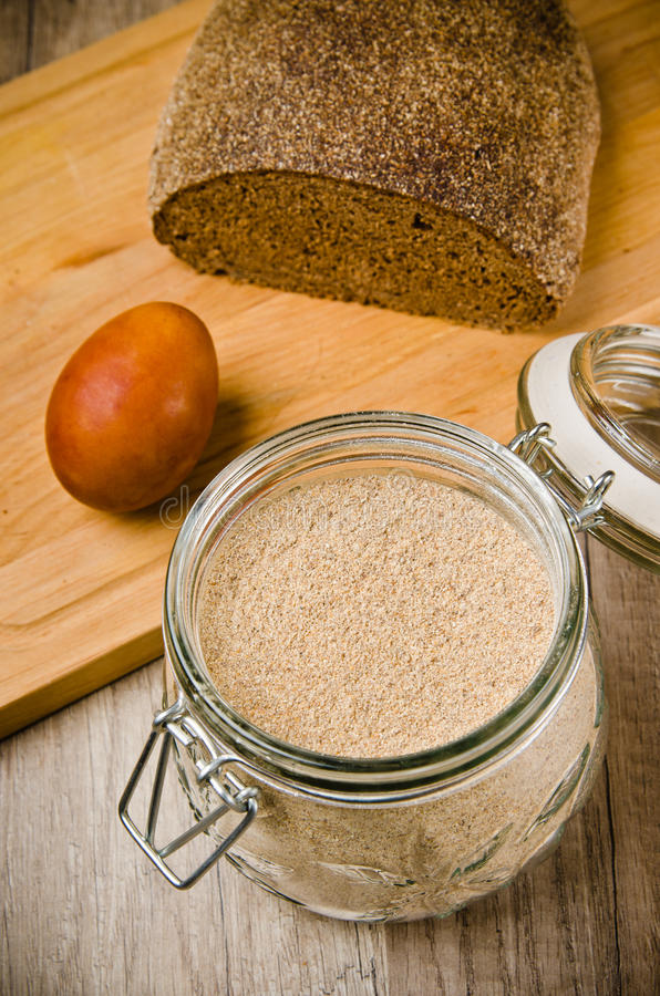 Black homemade bread, rye flour and egg royalty free stock images