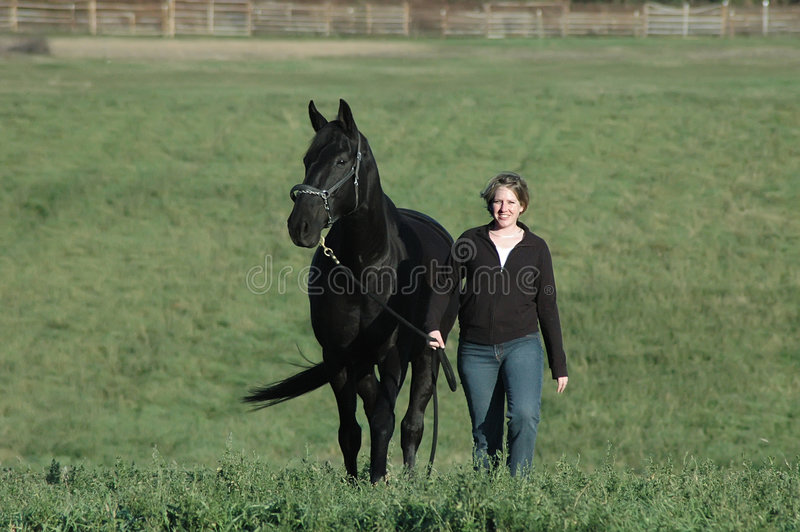 Download Black Horse And Woman Stock Photography - Image: 3531152