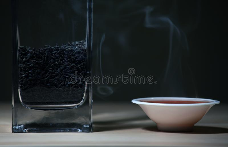 Black Hot Chinese tea cup smoke wooden table dark background nobody royalty free stock photos