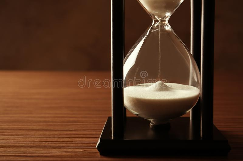 Black hourglass with white sand on background royalty free stock images