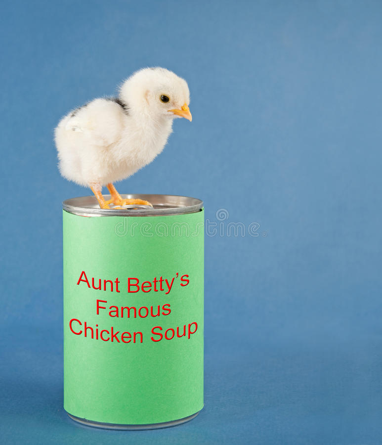 A black humor image of a chick standing on a can
