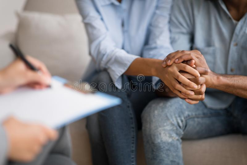 Black Husband And Wife Holding Hands At Marital Psychologist`s Office. Couples Therapy Concept. Unrecognizable Black Man And Woman Holding Hands At Marital royalty free stock photography