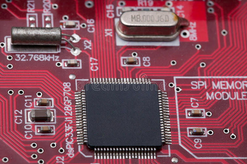 Black IC on red PCB.  stock photography