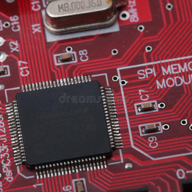 Black IC on red PCB.  royalty free stock photography