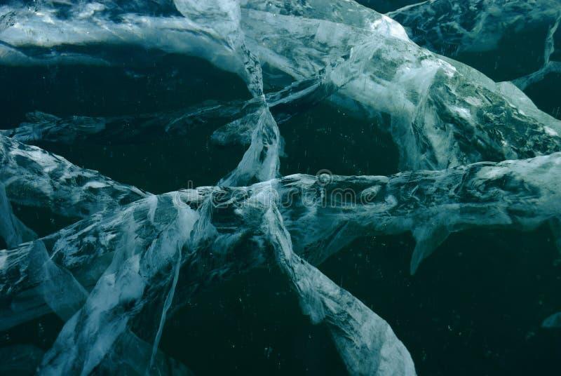 Black ice background. Black cracked ice background. Surface of frozen lake royalty free stock photo