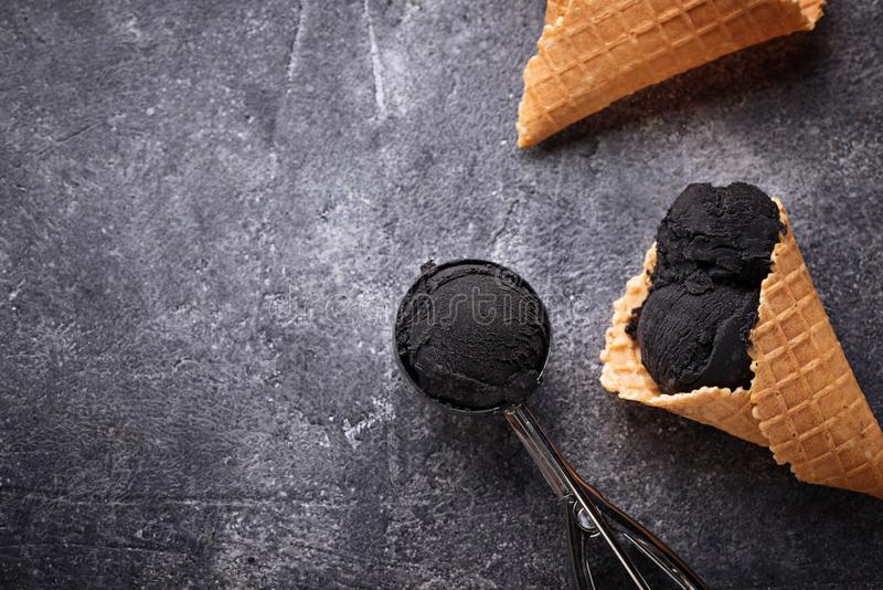 Black ice cream. Trendy food royalty free stock photography