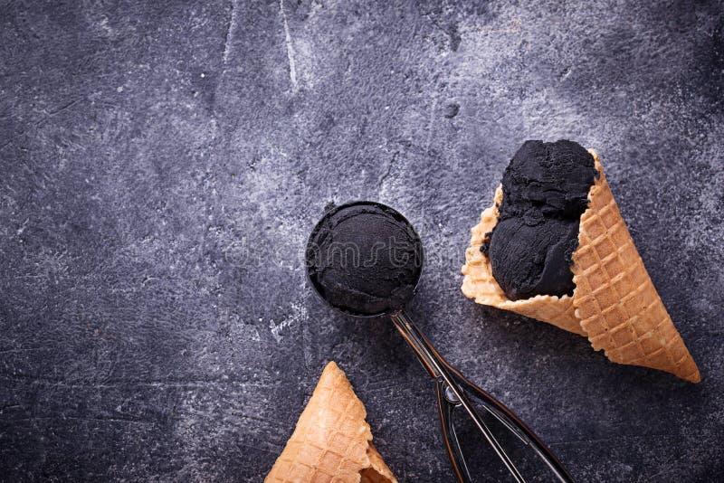 Black ice cream. Trendy food stock photo