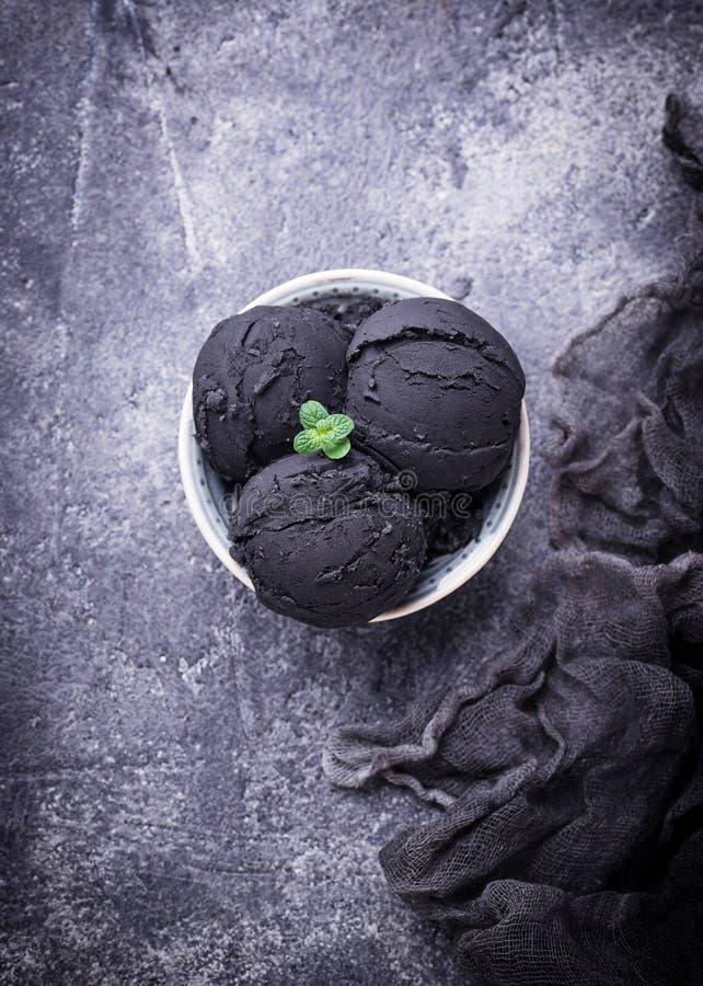Black ice cream. Trendy food stock photos