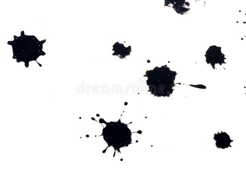 Black ink splatters stock photography