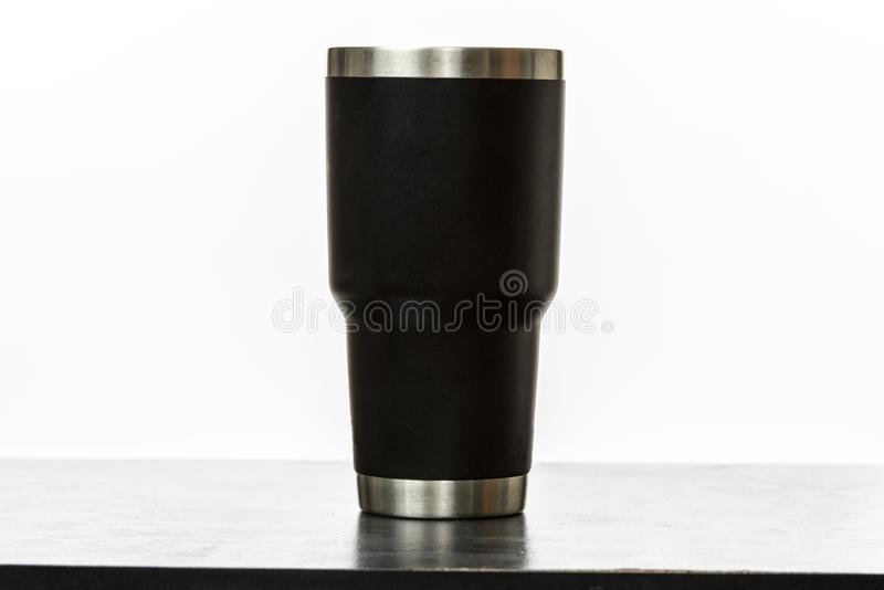 Insulated cup. Black insulated cup on white background stock photos