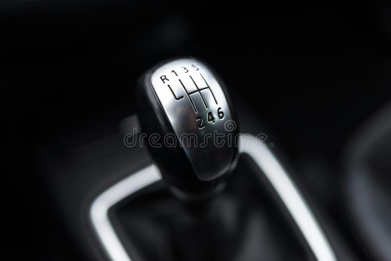 Black interior of a modern car, six-speed manual shift car gear lever. Black interior of a modern car, six-speed manual shift car gear lever royalty free stock image