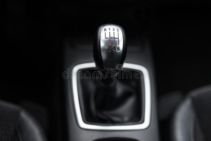 Black interior of a modern car, six-speed manual shift car gear lever. Black interior of a modern car, six-speed manual shift car gear lever royalty free stock photo