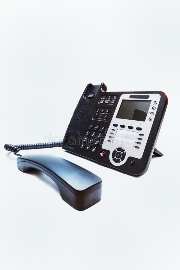 Black IP office phone closeup royalty free stock image