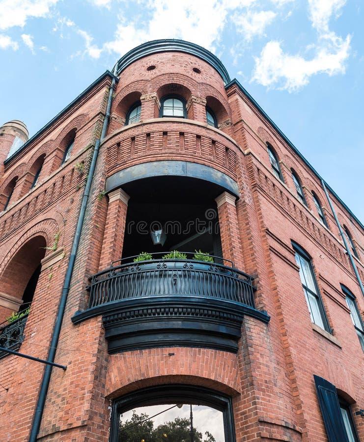 Old Brick Apartment Building: Black Iron Steps Up Brown Brick Apartments Stock Image