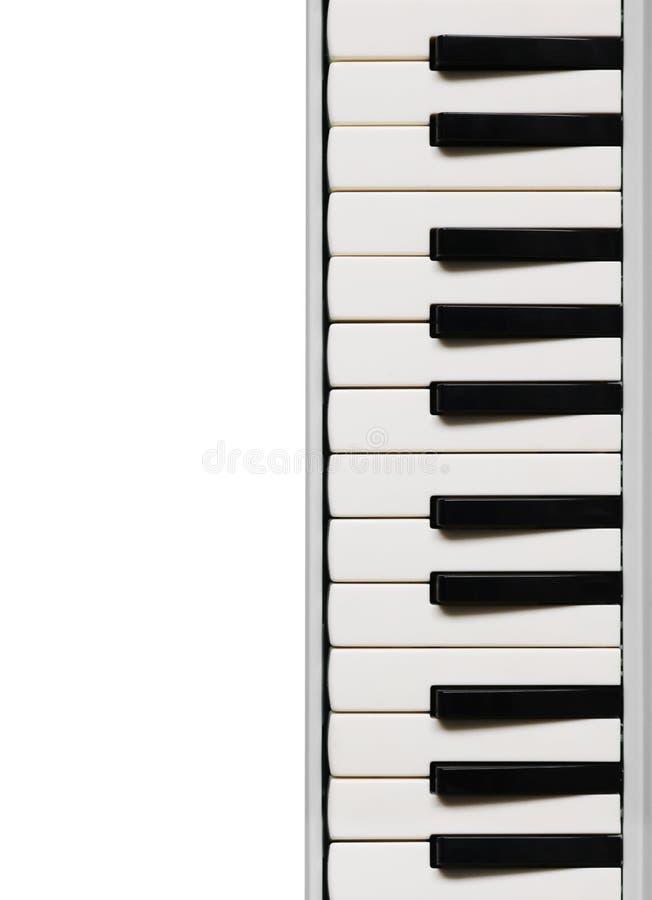 black ivory keys piano white Музыкальная плоская предпосылка стоковая фотография