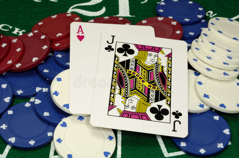 Black Jack. Photo of a Black Jack Hand and Chips - Gambling Concept royalty free stock images
