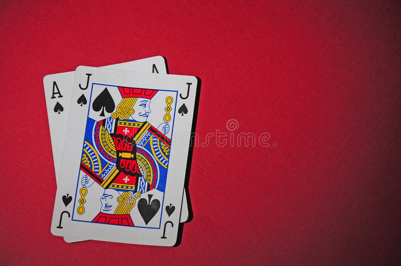 Black jack. And Black Ace on the red playing table stock image