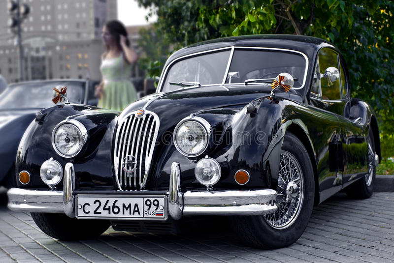 black jaguar xk120 classic on exhibition retro car. Black Bedroom Furniture Sets. Home Design Ideas