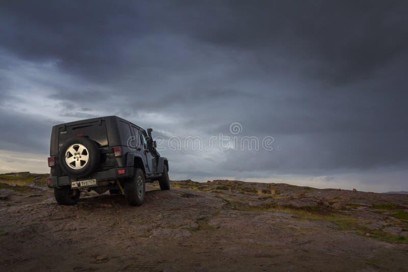 Black Jeep Wrangler Sahara royalty free stock image