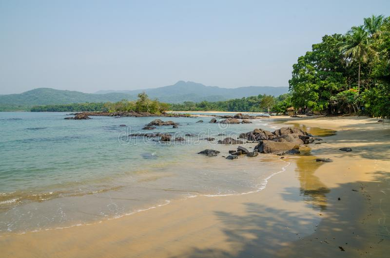 Black Johnson Beach in Sierra Leone, Africa with calm sea, ropcks, and deserted beach.  royalty free stock photography