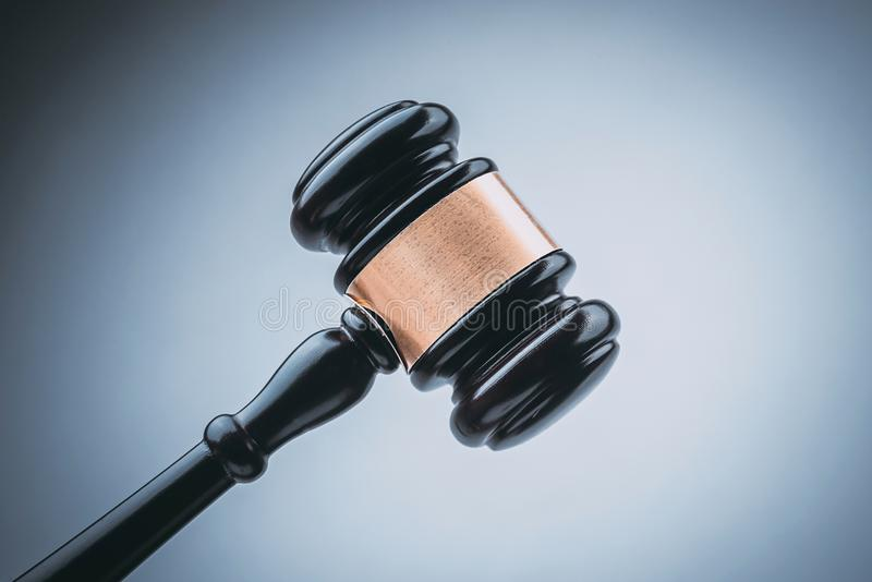 Black Judge Wood Hammer with blue background royalty free stock photography