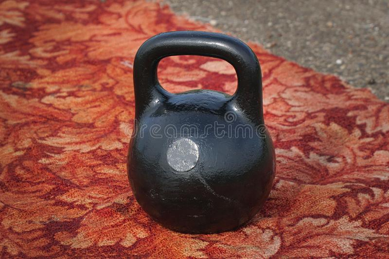 Black kettlebell with handle stock photography
