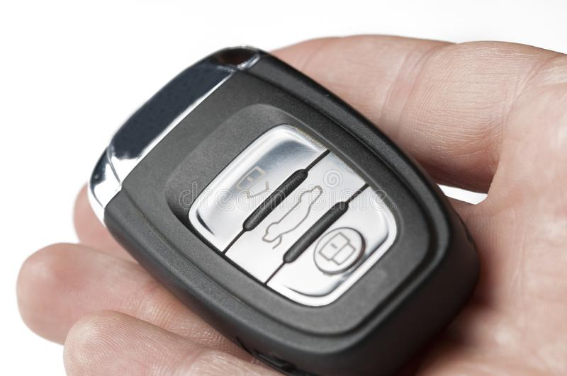 Black key of a car in hand isolated on a white background. Car key royalty free stock photography