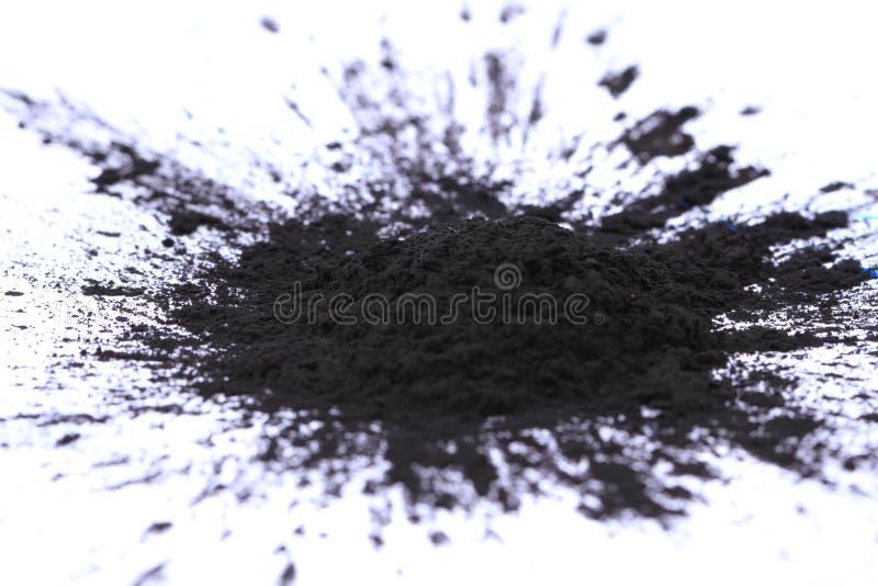 Black(key) toner powder. On white background stock photo