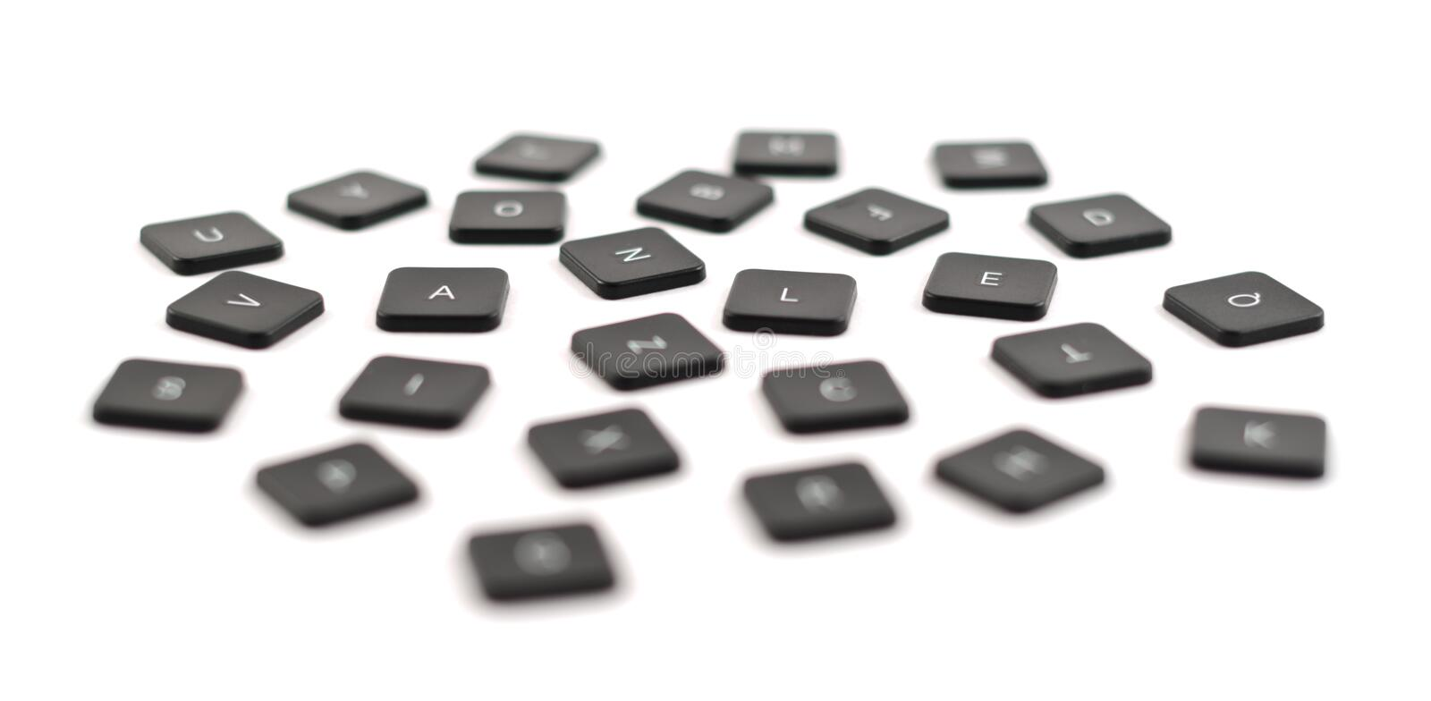 Black keyboard button composition isolated. Scattered black keyboard button composition isolated over the white background, shallow depth of field royalty free stock photography