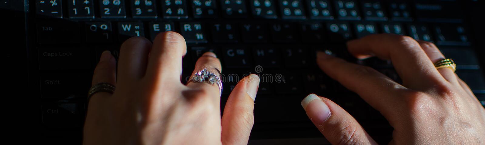 Typing a message on the black keyboard stock photo