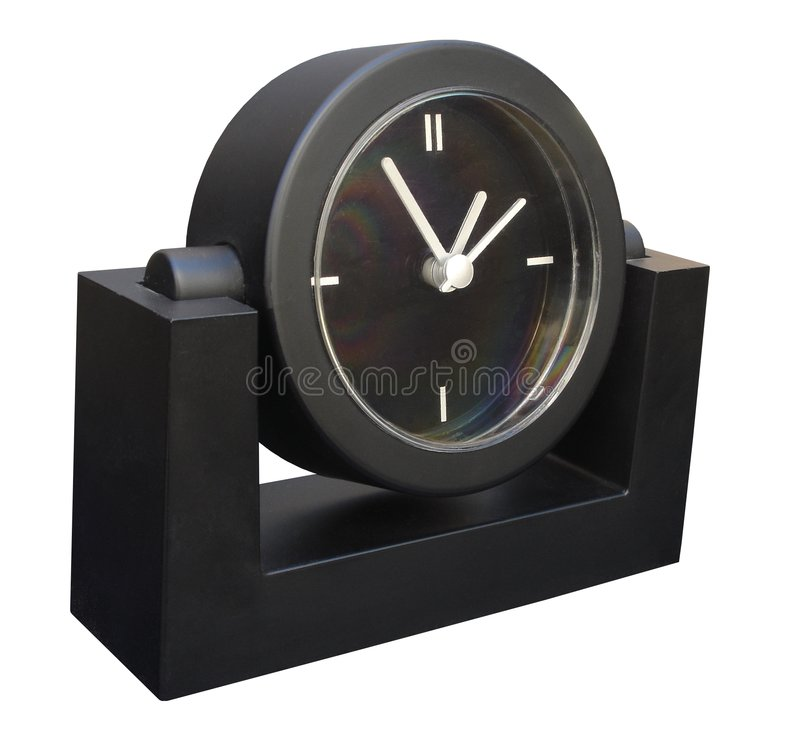 black klockaskrivbordet arkivfoto