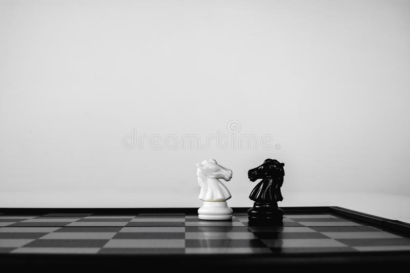 Black knight and White knight stand face to face. Business competition. competitiveness and strategy. Leader, courage, success, brave, hero, power, strong stock photo