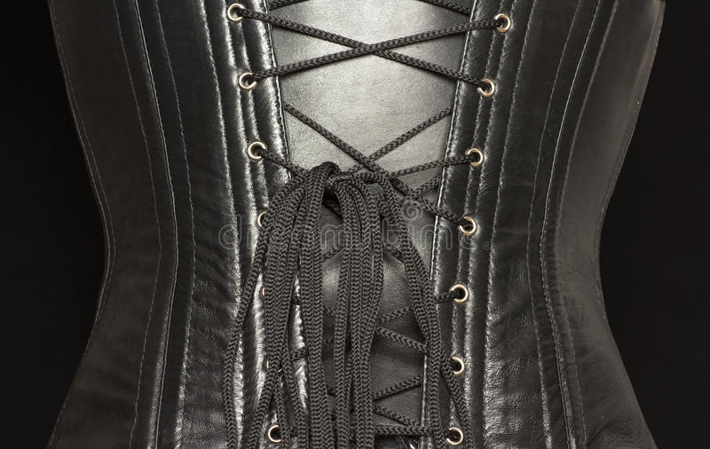 black korsettläder royaltyfria foton