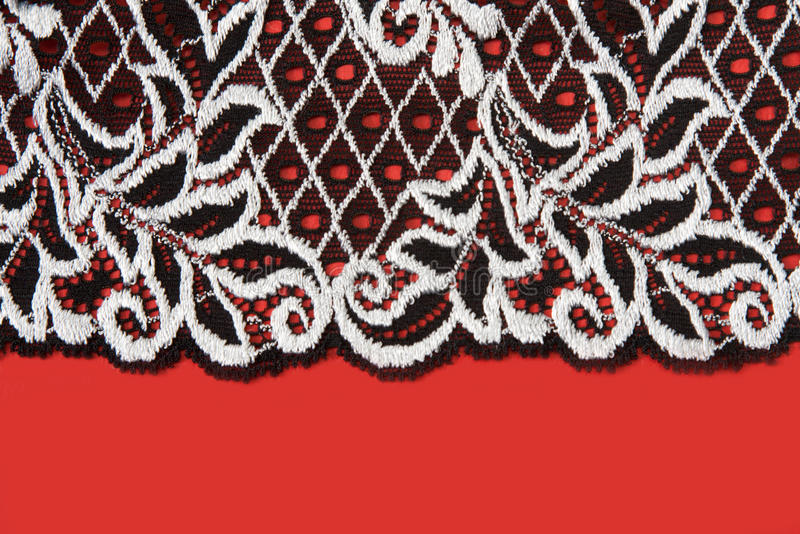 Black Lace Insulated On Red Background Royalty Free Stock Photography