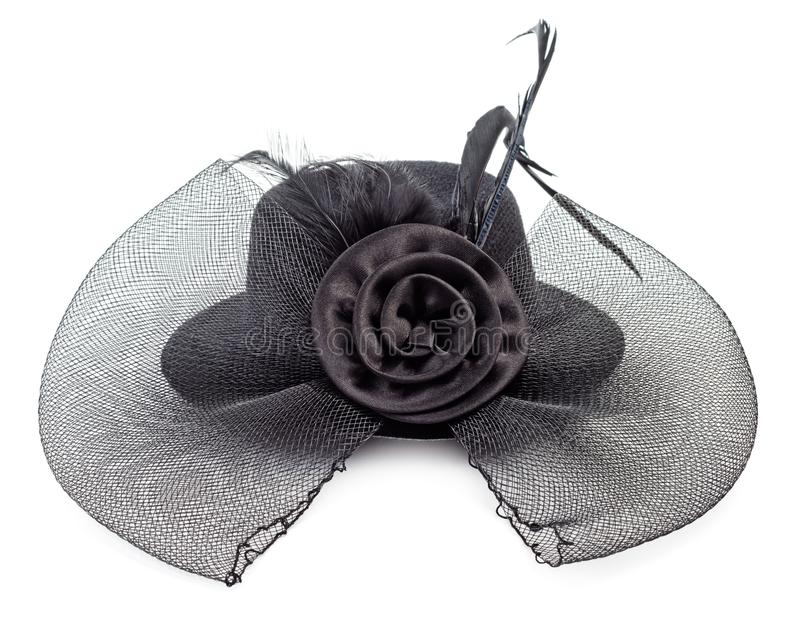 Black ladies hat isolated. Black antique ladies hat with flower isolated on white background royalty free stock photos