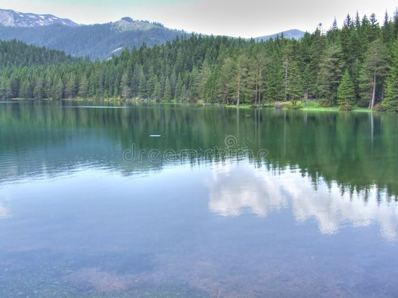 Black lake. With HDR effect. This lake is on the mountain Durmitor in Montenegro royalty free stock image