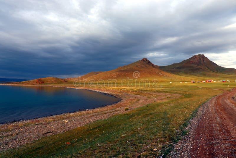 Black lake in mongolia during sunshine stock images